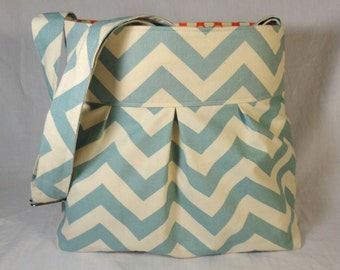 Diaper bag, purse medium pleated- baby blue chevron and amy butler red polka dot lining with bottle pockets and adjustable strap