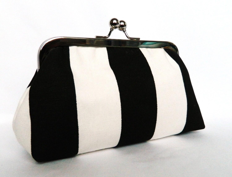 Black/white striped clutch - Black and white striped clutch purse with blue interior.