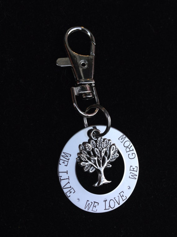 Personalized Key Chain with tree hand stamped with 'we live  we love we grow'