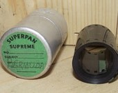Vintage 35mm Filmstrip with Metal Canister