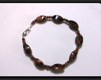 Glittering Goldstone Glass and Hematite 8.5 inch Bracelet   One of a Kind