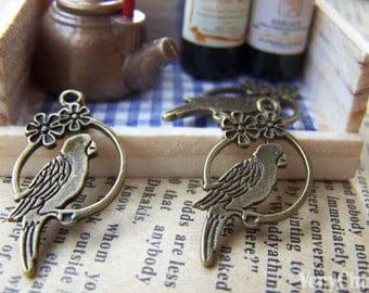 20 pcs of Antique Bronze Parrot Ring Charms 15x28mm A296