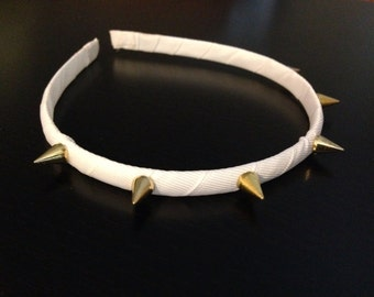White headband with gold spikes