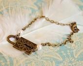 Delicate vintage brass lock keyhole charm bracelet with Swarovski pearls