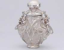 Mabe or blister Pearl topped Perfume bottle Pendant, in silver 925, with seed pearl and Amethyst bead neck-let.