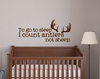 "To go to sleep I count antlers not sheep - vinyl wall decal - 13""H x 29""W"