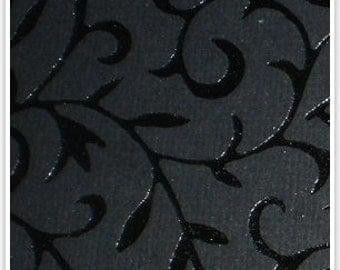 Handmade paper black on black shaded foil print