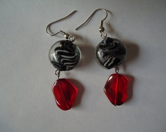 Glass beads, white, black, and red.