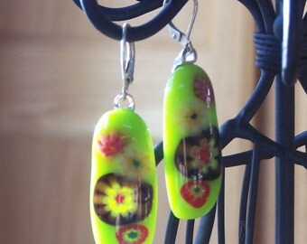 Retro look glass earrings with millefiore glass accents and sterling silver lever back wires.