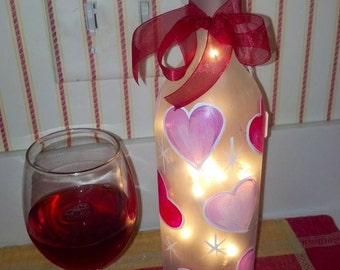 Romantic Lighted Wine Bottles for Valentines Day, Wedding, or Anniversary gifts.