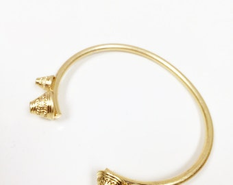 Gold cone open cuff bangle with intricate engraved details