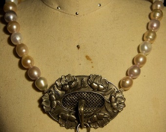 Antique pendant and freshwater pearl necklace