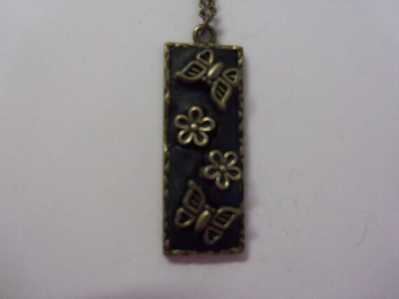 Bezel Pendant using black Epoxy clay and antique-gold butterfly & flower charms