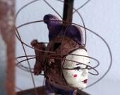 Fish Woman tangled in metal
