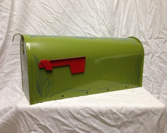 Hand pinstriped mailbox. Painted in green and pinstriped in blue.
