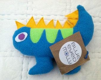 Handmade plush salamander is a cuddly baby toy