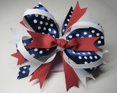Gorgeous Layered Hair Bow. Red, White, and Blue Hair bow perfect for every occasion for girls of all ages.