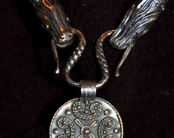 Silver pendant with a  filigree curls (Era of Vikings)