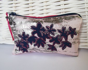 Embroidered textile purse with navy blossom silhouette design