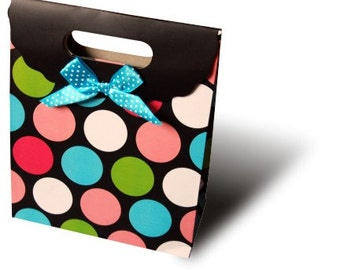 Polka dot gift bag with lime green tissue paper - the perfect way to wrap your gift!