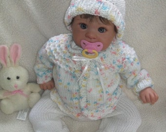 Hand knitted baby girl sweater and coordinated pom pom hat Cotton candy color