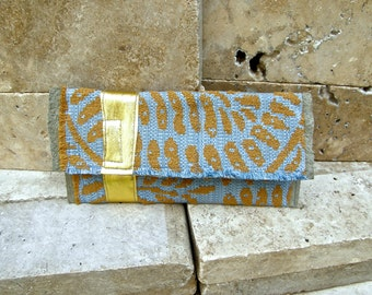 Carpet Bag Clutch with Blue Grey Leather, Italian Gold Leather and Textural Fabric with Ethnic Leaf Motif in Blue and Burnt Orange