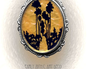 Early 20th C. Art Deco Silhouette Trees on Iridescent Celluloid in Tin Brooch