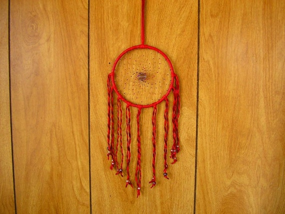 Dreamcatcher, 5 inch wrapped with Red leather, with beaded web in Czech glass beads and twisted deerskin  fringe