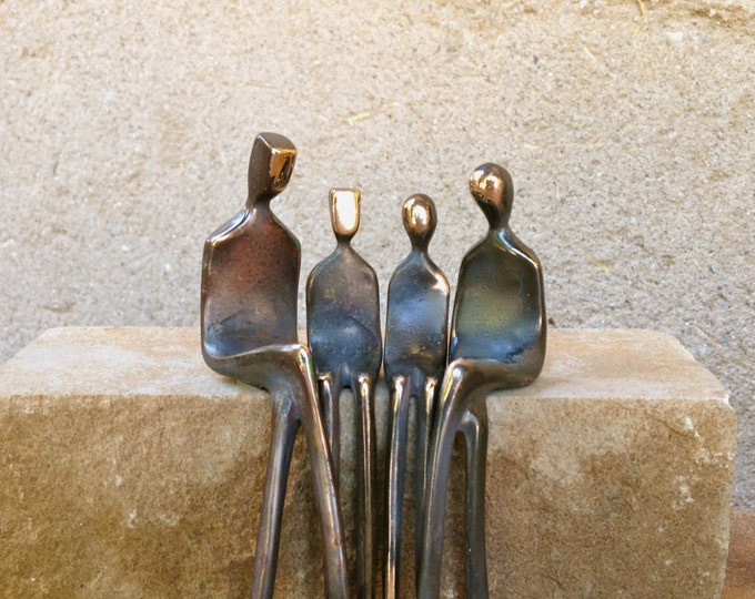 Family of Four: cast bronze family portrait