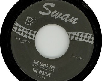 Vintage Vinyl. Beatles She Loves You / I'll Get You Swan Records 45 rpm Single S-4152 Black Label Silver Printing with Don't Drop Out