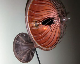 Vintage adjustable wall mount lamp upcycled from 1920s Majestic No. 7 electric copper radiant heater