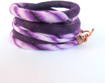 African hand dyed batik fabric,  wrap bracelet ,african purple,Mauve and lavanda,