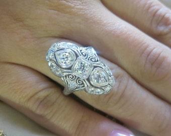 Antique Platinum round diamond ring