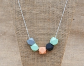 Grey, Mint, Peach and Black Wooden Geometric Necklace