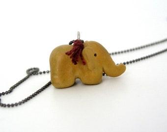 Baby elephant pendant, polymer clay, animal necklace, elephant figurine, mustard yellow burgundy red thread, miniature, spirit animal, totem