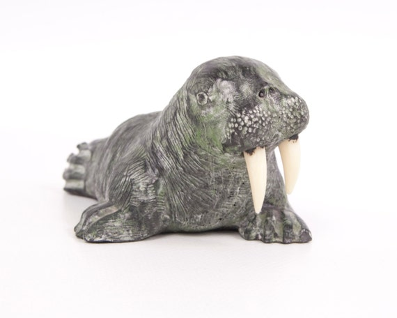 Vintage walrus figurine the wolf sculptures by