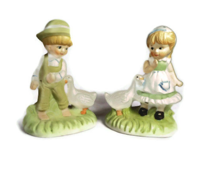 Boy and girl figurines, old fashioned ceramic boy and girl with duck figurines from Brinn's of Pittsburgh