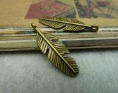 50PCS antique bronzed tone 9x23mm feather charm pendant- W1423