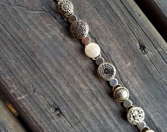Single Strand Brass Button Bracelet