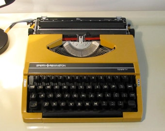 Vintage Manual Portable Typewriter Sperry Remington Ten Fifty with hard case Mustard Yellow color  Working Typewriter