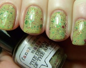 CLEARANCE The Dream of the Apples Nail Polish - light green with red, green, and gold glitter