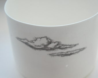 White vase. English fine white bone china vessel or tealight holder in stoneware with a cloud illustration.