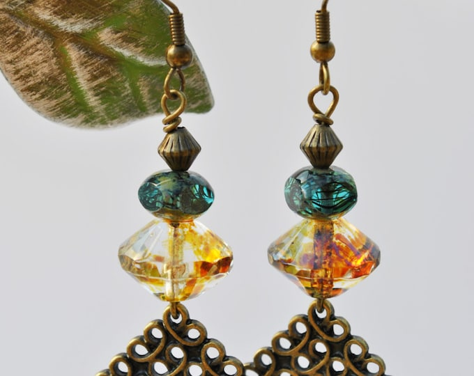 Amber Bicone and teal Czech glass earrings with intricately carved brass diamonds