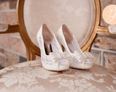 Ladies Lace Bridal Shoes in Ivory. Peep Toe with cute bow. Soft fabric with 10cm heels. Style: AT LAST P1402