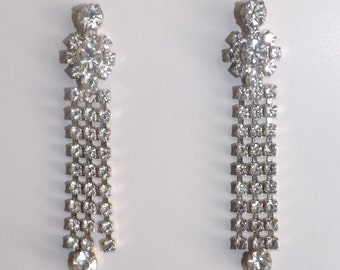Long and lovely rhinestone dangle earrings with bright, clear stones