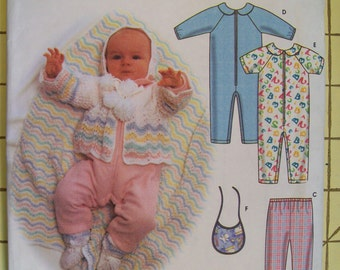 Simplicity 9493. Babies' bib and knit top, Pants and Romper. Also includes knitting patterns. Sizes XXS, XS, S, M. Uncut and factory folded.