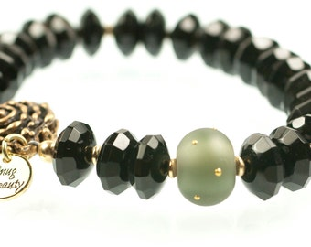 Glitter Gulch Bracelet - faceted black onyx, lampwork bead, gold and bronze