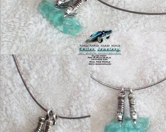 "Authentic movie artifact choker made with ""It's a Mad, Mad, Mad, Mad World"" car glass under ice skate charms."