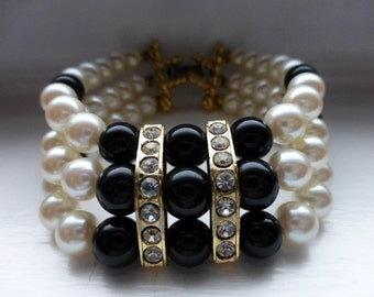 Triple Strand Black Bead and Creamy Faux Pearl Bracelet with Rhinestone Accents