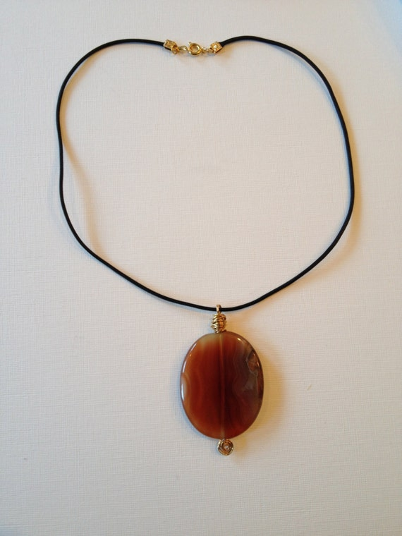 Necklace with orange brown agate oval gemstone with black leather thread